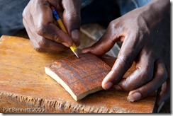 Making an adinkra stamp from calabash, Ntonso, Ghana.
